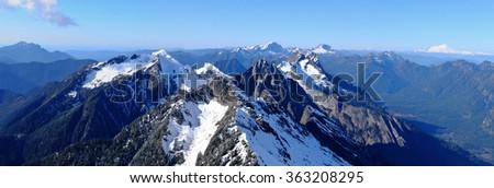 Panoramic View of Snowy Mountains. The Cascade Mountains, Washington - stock photo