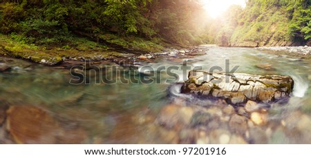 Panoramic view of Sochi river in mountains nearer to the river head, lens flares - stock photo
