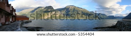 Panoramic view of Sogne Fjord Norway. On the picture there are mountains, kemping and a man with two dogs - stock photo