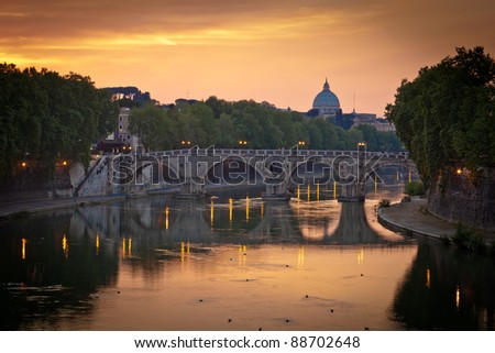 Panoramic view of St. Peter's Basilica and the Vatican City (with the river Tiber winding around it) at sunset - Rome, Italy - stock photo