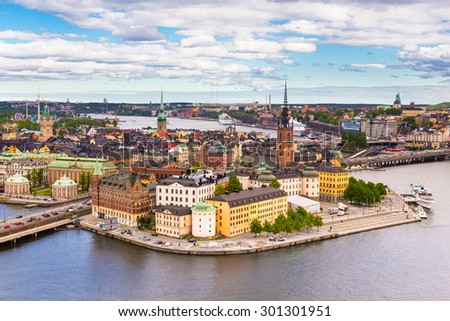 Panoramic view of swedish capital Stockholm seen from the city hall tower. Aerial view of Gamla stan, old medieval downtown. Horizontal composition.