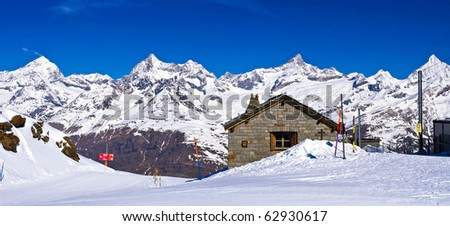 Panoramic view of Swiss alps with Train Station located at Gornergrat in Switzerland - stock photo