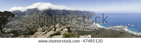 Panoramic view of Table Mountain, Camps Bay Beach, Cape Town city bowl, in the Western Cape Province of South Africa, as seen from Lion's Head, a famous landmark in this area - stock photo