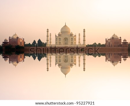 Panoramic view of Taj Mahal at sunset with reflection, Agra, Uttar Pradesh, India. - stock photo