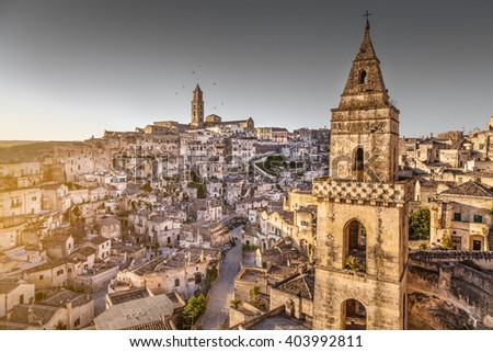 Panoramic view of the ancient town of Matera (Sassi di Matera), European Capital of Culture 2019, in beautiful golden morning light at sunrise, Basilicata, southern Italy - stock photo