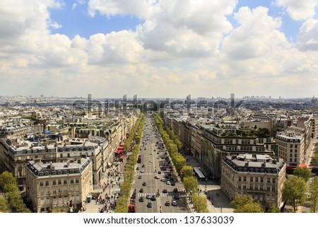 Panoramic view of the avenue des Champs Elys�©es and parisian rooftops from the top of the Arc de Triomphe - stock photo