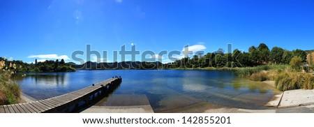 Panoramic view of the Blue Lake in Rotorua, New Zealand - stock photo