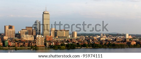 Panoramic view of the Boston, MA riverfront neighborhoods of Back Bay and Brookline, including the landmark Prudential Tower. Seen from near Kendall/MIT across the Charles river in Cambridge, MA. - stock photo