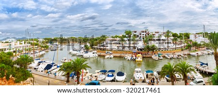 Panoramic view of the Cala D'Or yacht marina harbor with recreational boats. Mallorca, Spain