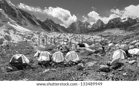 Panoramic view of the camp of climbers on Khumbu glacier near legendary place EBC - Nepal, Himalayas (black and white) - stock photo