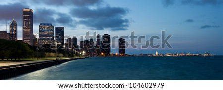 Panoramic view of the Chicago skyline and navy pier at dusk - stock photo