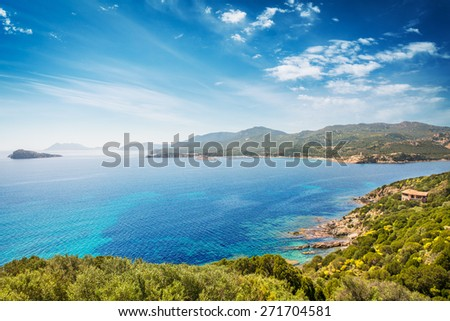 Panoramic view of the coast of Teulada in Sardinia, in a sunny spring day - all is perfectly illuminated and noise is completely absent, focus is on the horizon