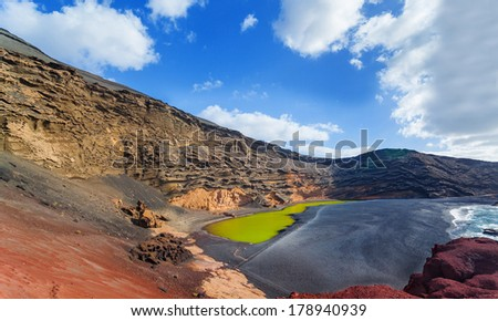 Panoramic view of the El Golfa beach in Lanzarote, Spain. - stock photo