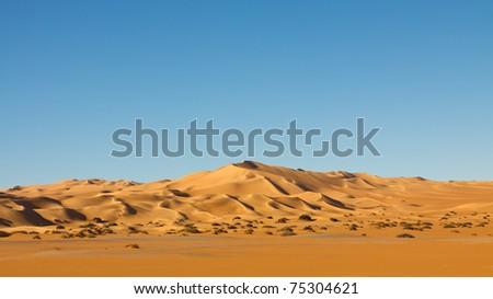 Panoramic View of the Endless Sand Dunes in the Awbari Sand Sea, Sahara Desert, Libya - stock photo