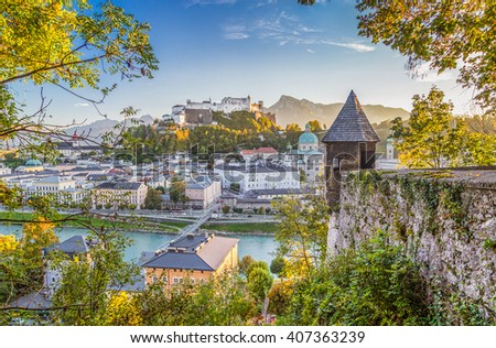 Panoramic view of the famous historic city of Salzburg with Hohensalzburg Fortress and Salzach river in beautiful golden evening light at sunset with blue sky and clouds, Salzburger Land, Austria - stock photo