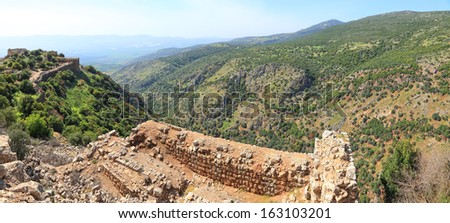 Panoramic view of the Golan Heights from fortress Nimrod - the medieval fortress located in northern part of the Golan Heights, on a crest about 800 m high above sea level. National park, Israel - stock photo