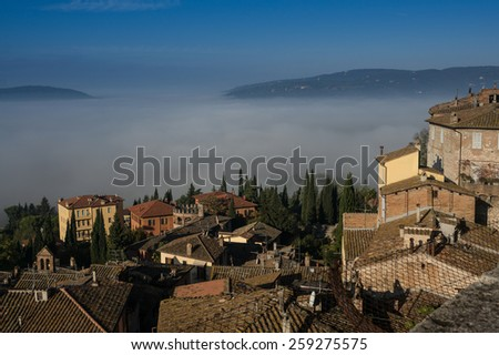 Panoramic view of the historic center of Perugia with the fog