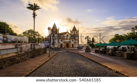 Panoramic view of the historic city of Olinda in Pernambuco, Brazil showcasing its cobblestone streets and buildings dated from the 17th century at sunrise.