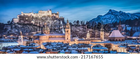 Panoramic view of the historic city of Salzburg with Hohensalzburg Fortress in winter at blue hour, Salzburger Land, Austria - stock photo