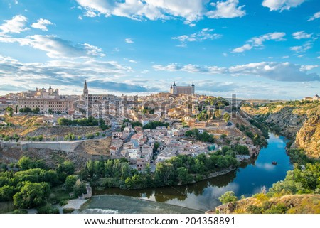 Panoramic view of the historic city of Toledo with river Tajo at sunset in Castile-La Mancha, Spain - stock photo
