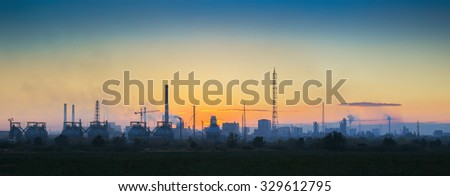 Panoramic view of the industrial landscape at sunset - stock photo