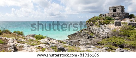 Panoramic view of the main temple  in the ancient Mayan city Tulum, Mexico. - stock photo