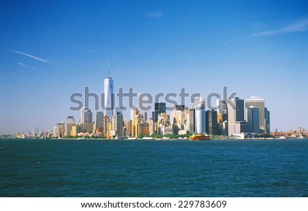Panoramic view of the Manhattan Island on a sunny day from the Staten Island Ferry. - stock photo