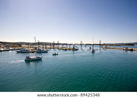 Panoramic view of the marina exit - stock photo