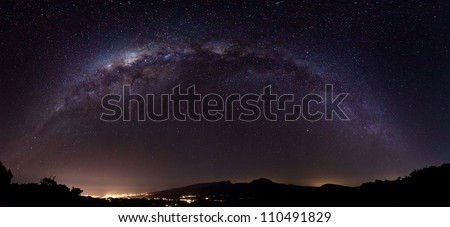 Panoramic view of the Milky Way in the night sky over Reunion Island. - stock photo
