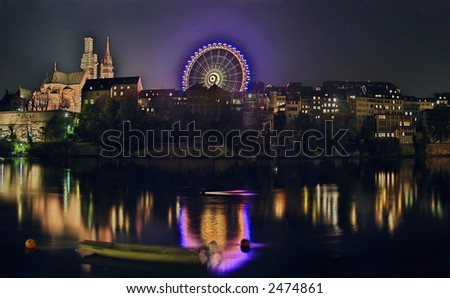 "Panoramic view of the Minster Cathedral in the Swiss city of Basel during the ""Herbstmesse"" (autumn fair). - stock photo"