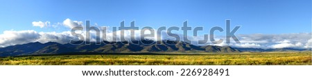 Panoramic view of the mountains and plains of northern New Mexico taken in the autumn - stock photo