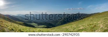 Panoramic view of the mountains in an amazing evening light - Svydovets range, Carpathians, West Ukraine - stock photo