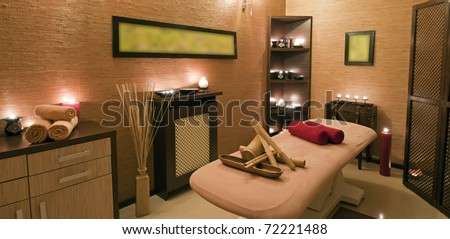 Panoramic view of the nice massage room in spa saloon. - stock photo