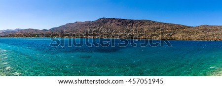 Panoramic view of the northern coast of the island of Crete (Greece), on the part of the Cretan Sea, the Gulf of Mirabello.