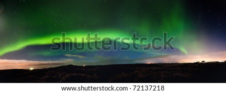 Panoramic view of the Northern Lights, Iceland 2011. grainy image - stock photo
