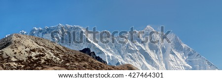Panoramic view of the Nuptse wall (top 7864 m) and Lhotse peak (8516 m) - Everest region, Nepal, Himalayas - stock photo