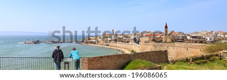 Panoramic view of the Old city of Akko and people on the observation deck, watching at a beautiful landscape. Akko (Acre) city, Israel - stock photo