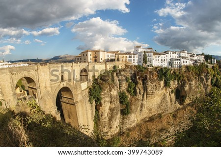 Panoramic view of the old city of Ronda, one of the famous white villages, at sunset in the province of Malaga, Andalusia, Spain (Fisheye Lens) - stock photo