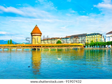 Panoramic view of the older wooden bridge of Europe in Lucerne Switzerland - stock photo