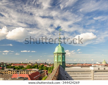 Panoramic view of the roof and tower from the observation deck at the Round tower (Rundetaarn) in Copenhagen, Denmark - stock photo