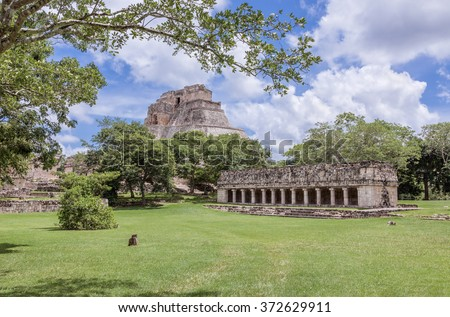 Panoramic view of the rotunda and the pyramids in the ancient city Uxmal - Yucatan, Mexico - stock photo