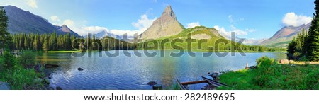 panoramic view of the Swiftcurrent lake in high alpine landscape on the Grinnell Glacier trail, Glacier national park, Montana in summer - stock photo