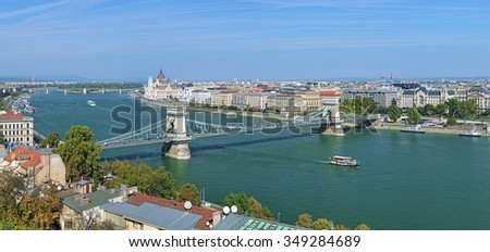 Panoramic view of the Szechenyi Chain Bridge over Danube and the Hungarian Parliament Building in Budapest, Hungary - stock photo