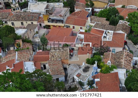 Panoramic view of the traditional Anafiotika neighborhood a maze of narrow streets and small houses built under the Acropolis by migrants from Anafi. Village style architecture in Athens, Greece. - stock photo