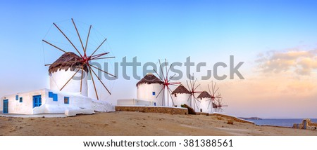 Panoramic view of traditional greek windmills on Mykonos island at sunrise, Cyclades, Greece