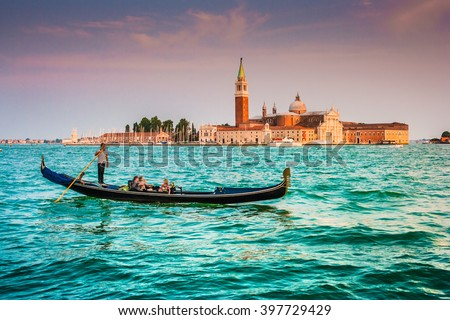 Panoramic view of traditional old Gondola on Canal Grande with historic San Giorgio Maggiore church in the background in beautiful golden evening light at sunset in summer, San Marco, Venice, Italy - stock photo