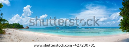 panoramic view of tropical anse severe beach on la digue island in seychelles - stock photo