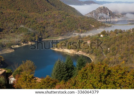 Panoramic view of Turano lake in lazio with fog - Italy.