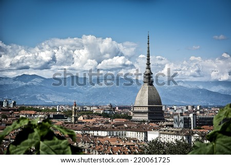 Panoramic view of Turin city center, in Italy, in a sunny day, with Mole Antonelliana and Alps in the background - stock photo