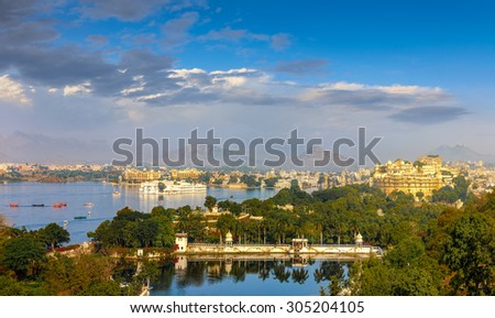 Panoramic view of Udaipur, Lake Pichola and City Palace - Rajasthan, India, Asia - stock photo